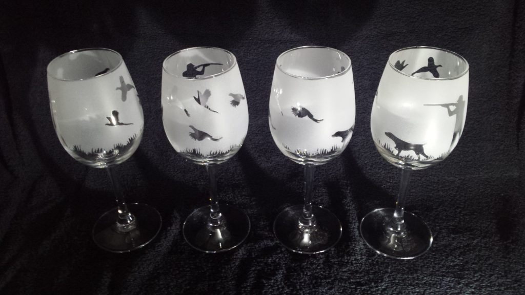 A set of reverse etched wine glasses with wrap around design