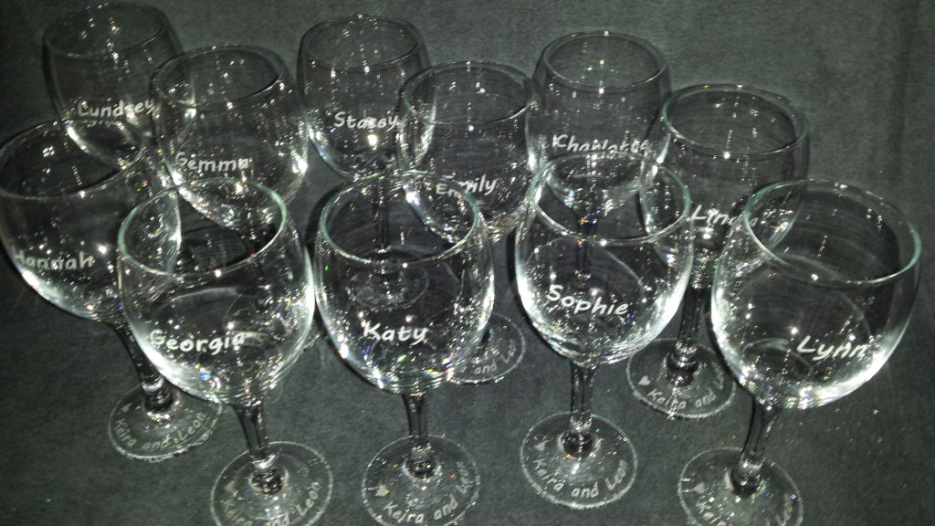 A batch of wine glasses etched with individual names